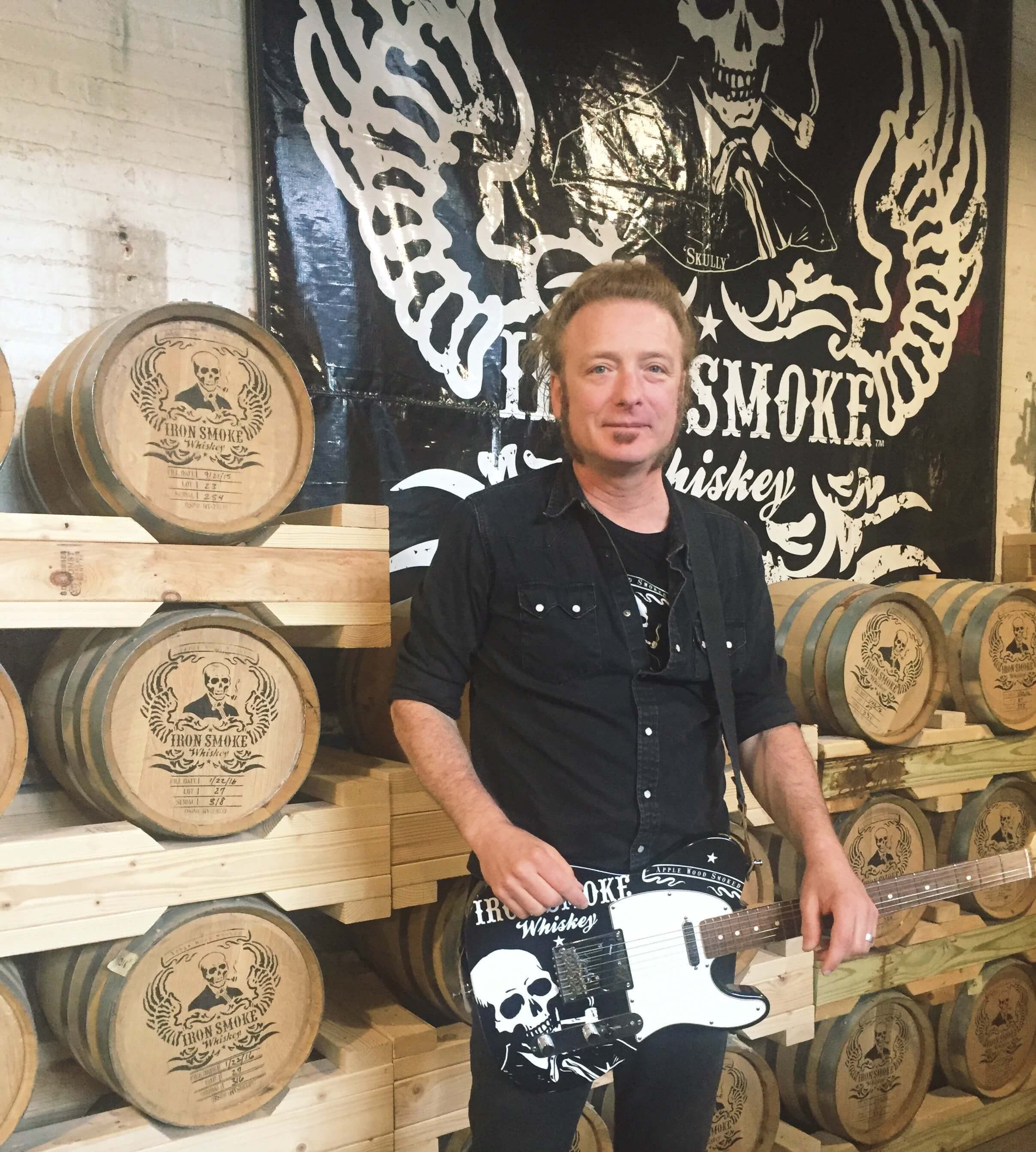 Iron Smoke Whiskey Founder Tommy Brunett is excited about creating jobs in Rochester and (of course) making whiskey.